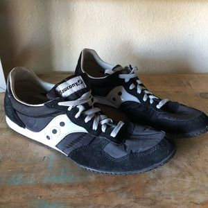 Men's Saucony black and white running shoes